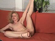 Blonde bare on the couch in nothing but heels, showing her pussy and ass